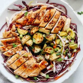 overhead shot of cabbage salad with grilled chicken