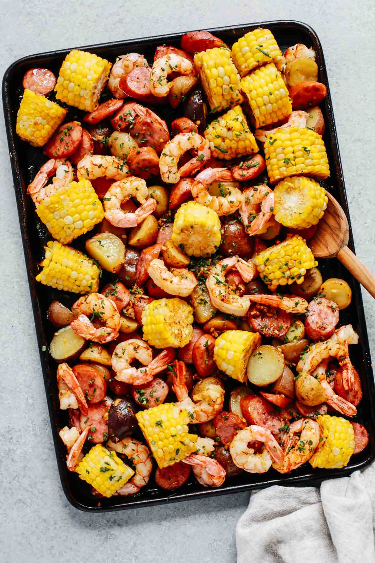 overhead photo of shrimp boil on a baking sheet