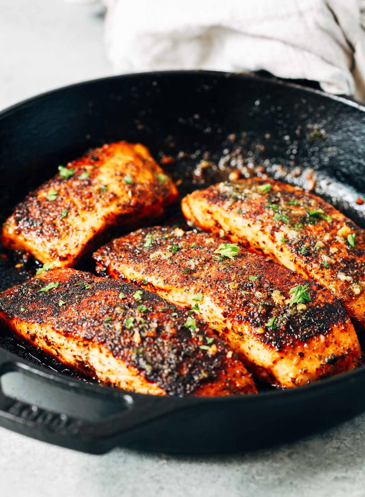 close up of Blackened salmon in a cast iron skillet