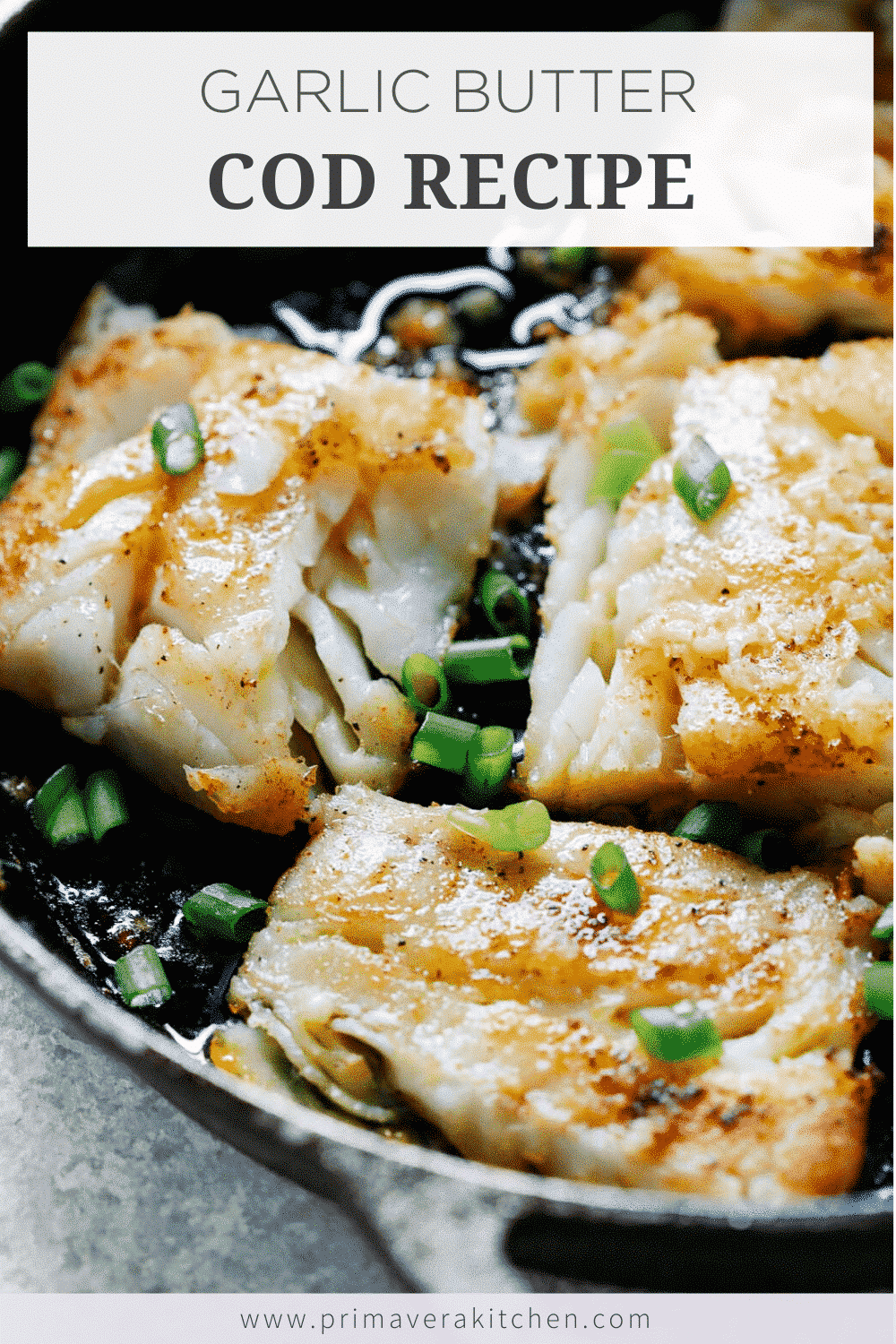 close up of white fish fillets garnished with scallions cooking in cast iron skillet