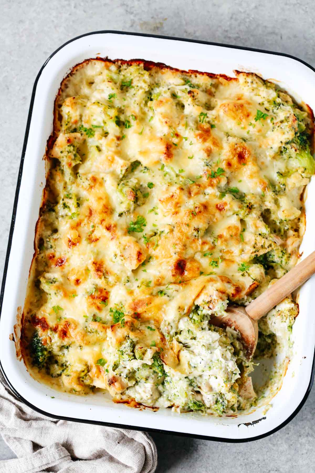 Overhead photo of a baking dish containing broccoli and cauliflower casserole.