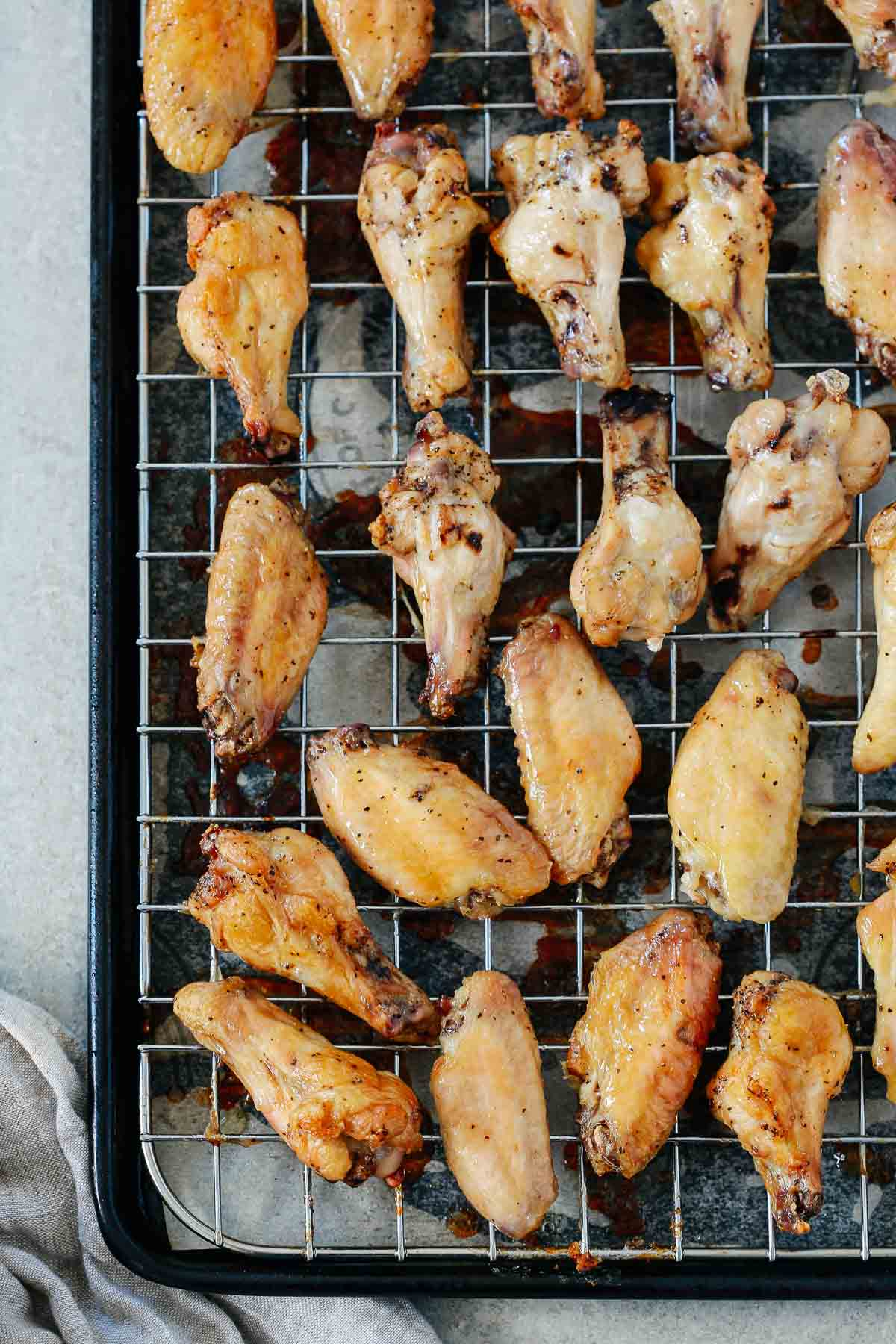 close up of chicken wings on a cooling rack