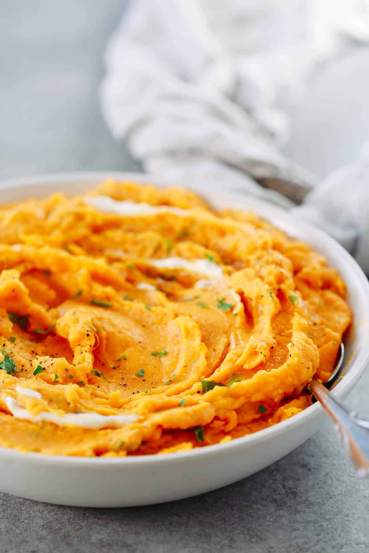 Close up of a bowl of savory mashed sweet potatoes.