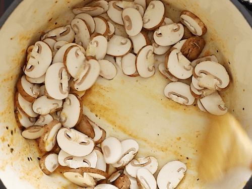 overhead view of a large pot containing mushrooms
