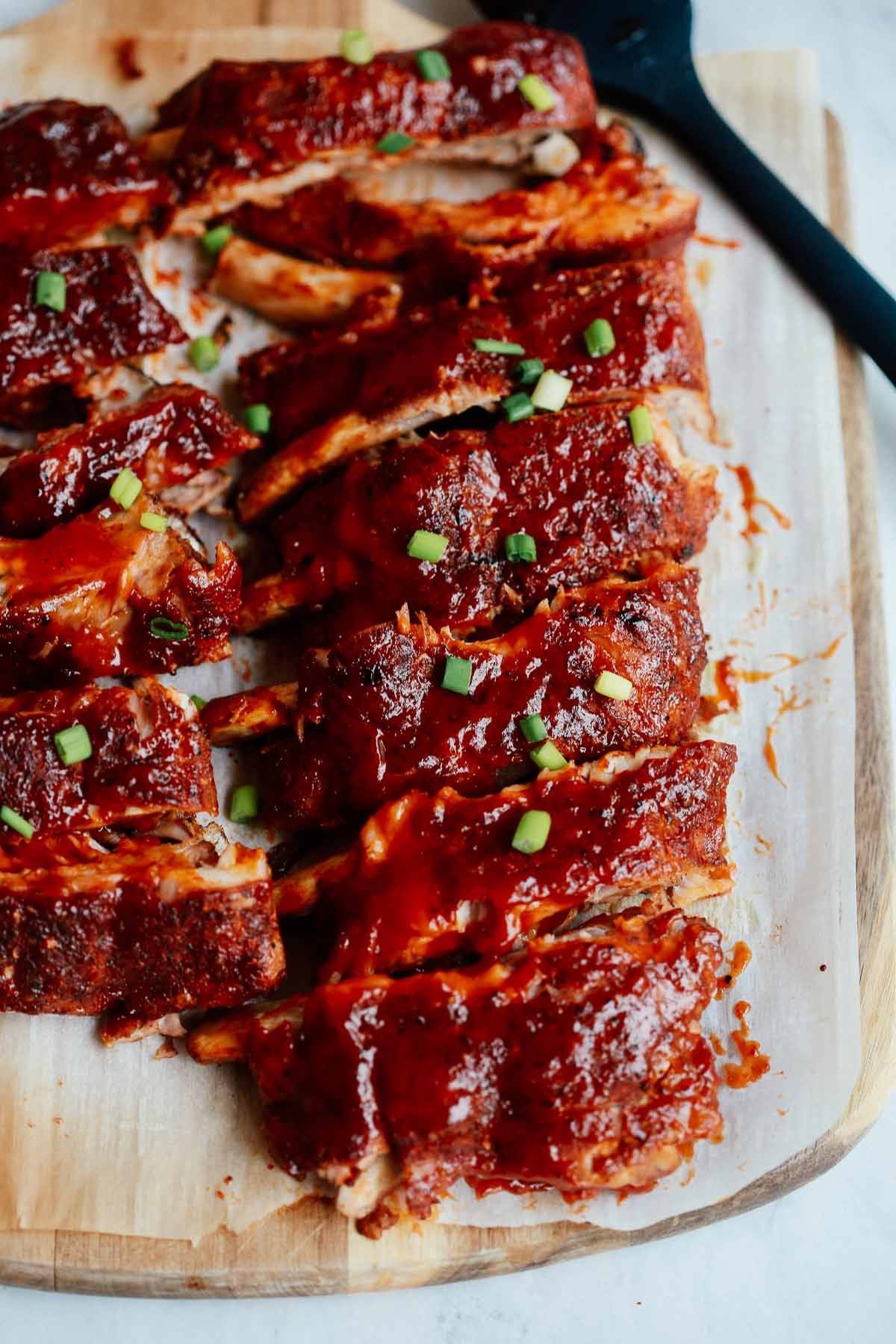 Close up of a rack of oven baked ribs.