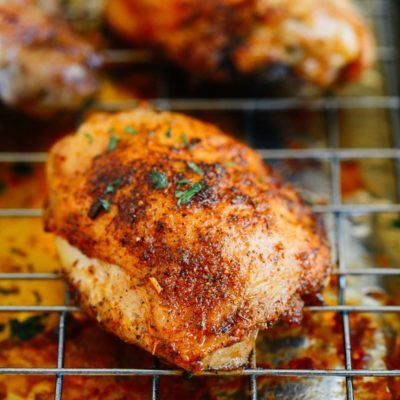 A close up of a chicken thighs on a rack