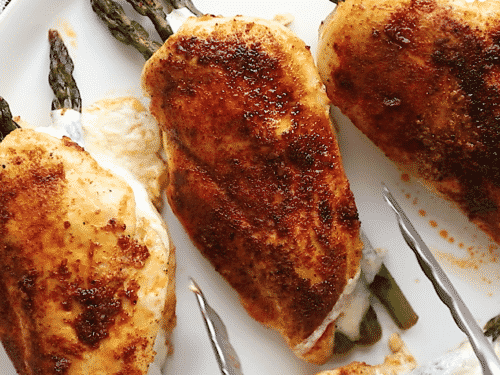 close up of asparagus stuffed chicken breast
