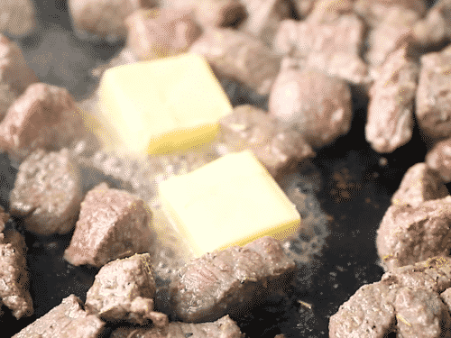closeup of diced beef and cubes of butter