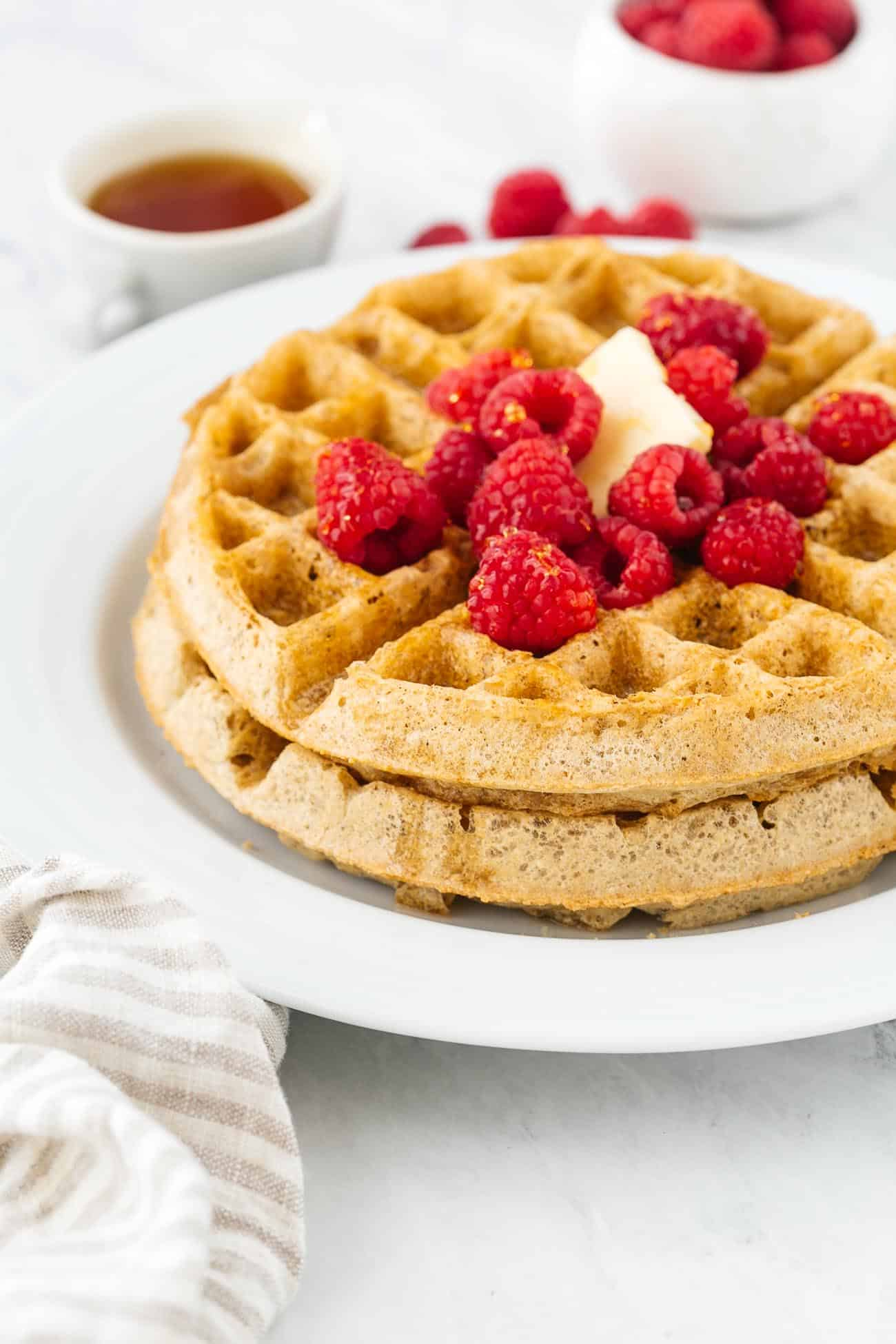 Close up of gluten free waffles with fresh berries.