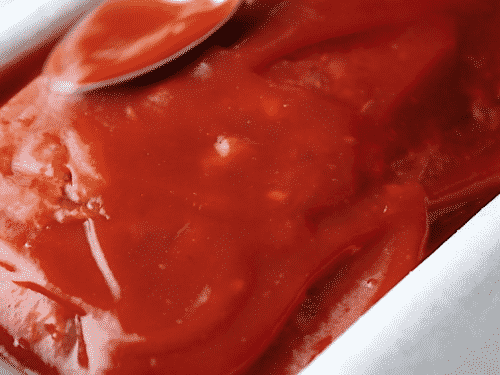 closeup of ketchup on top of meatloaf