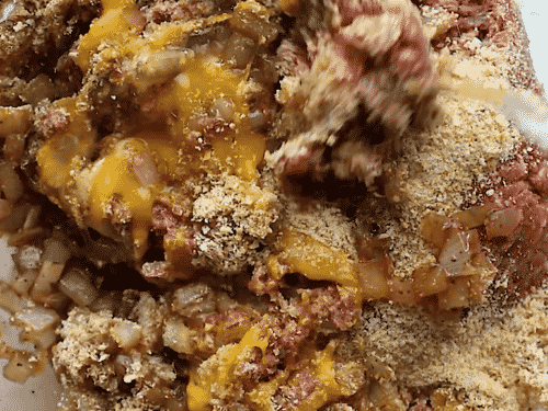 overhead view of meatloaf ingredients in a bowl