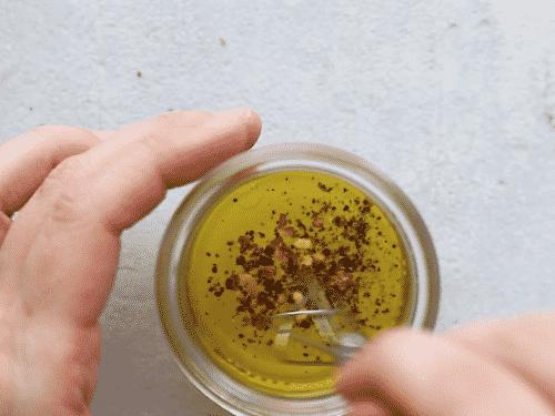 close up of a salad dressing in a mason jar