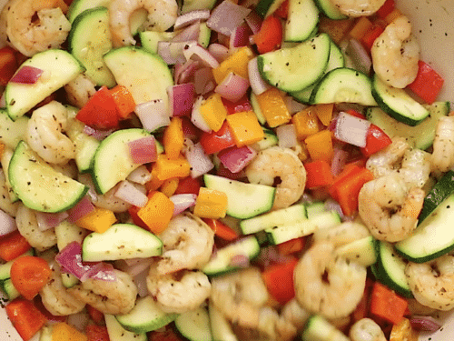 overhead view of shrimp and veggies in a skillet