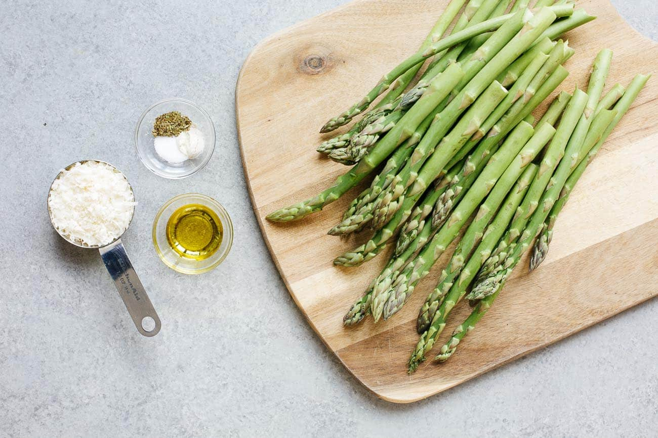 overhead view of ingredients to make air fryer asparagus