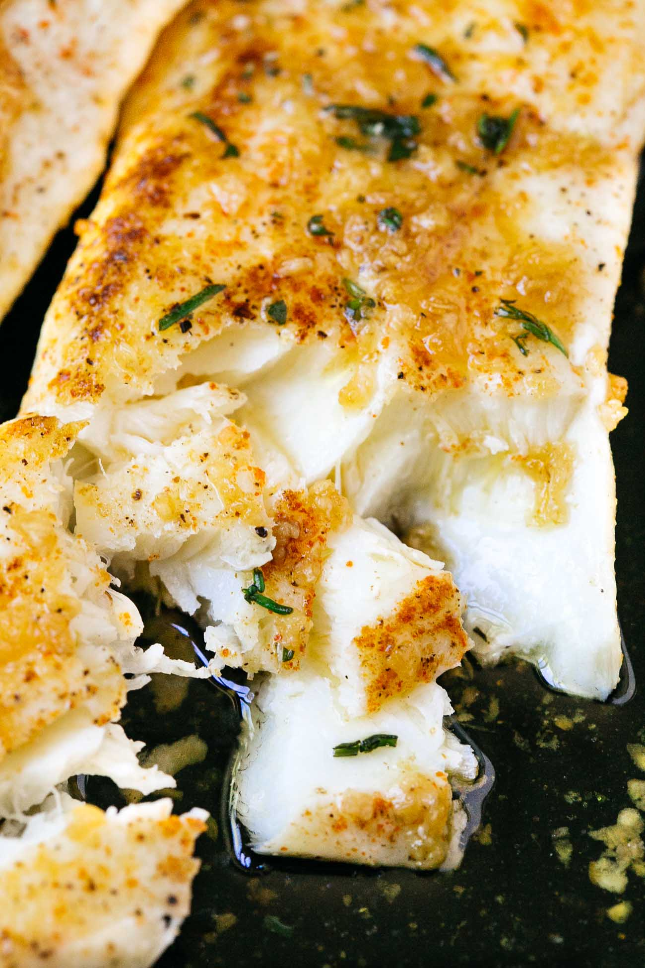 close up of flaky garlic butter halibut fish