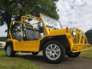 Moke Yellow black seats white piping side view