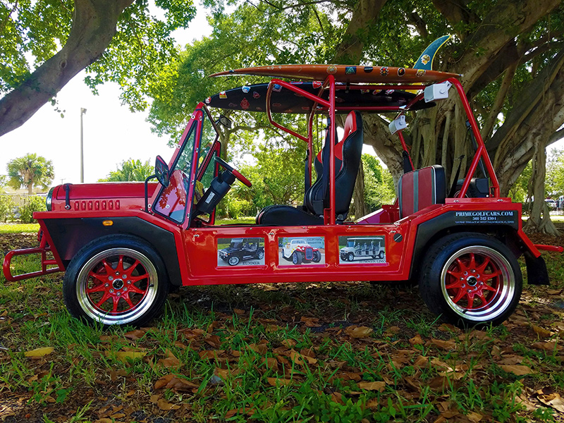 red moke golf car with custom accessories