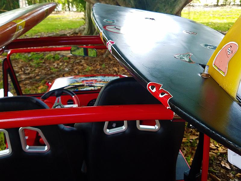 surfboard on a moke golf car