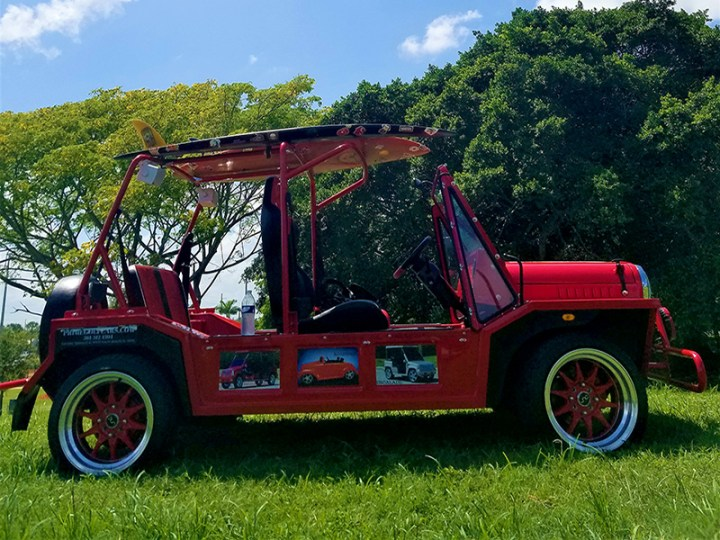 red moke golf car with custom wheels