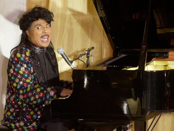 In this 2001 photo, Little Richard sings on Milton Berle's 93rd birthday and 88th birthday in Beverly Hills, California.