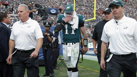 LOS ANGELES, CA - DECEMBER 10:  Carson Wentz #11 of the Philadelphia Eagles is escorted off the field at the end of the third quarter during the game against the Los Angeles Rams at the Los Angeles Memorial Coliseum on December 10, 2017 in Los Angeles, California.  (Photo by Jeff Gross/Getty Images)