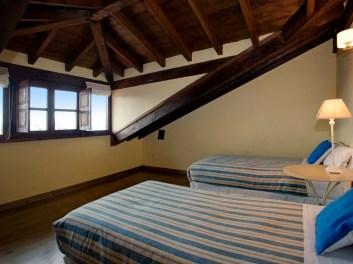 Schlafzimmer in Ferienhaus für 10 Personen