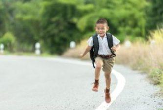 child running on the roadside