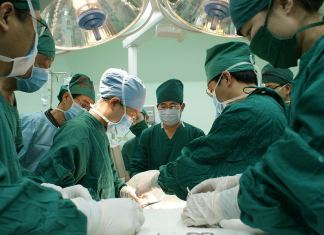 A photo of surgeons operating on a patient.