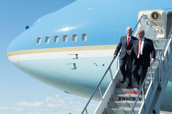 A photo of Donald Trump and Mike Pence leaving Air Force One