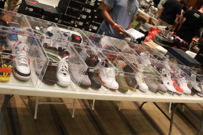 A large collection of Air Jordans sneakers in glass boxes.
