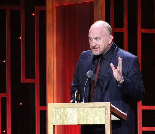 A photo of Louis CK at an awards ceremony
