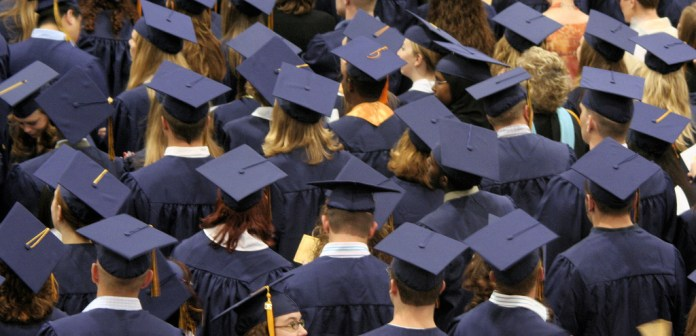 An image of high school graduates during a commencement ceremony.