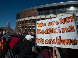 An image of a protest outside a Washington Redskins football game.