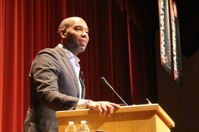 A photo of Ta-Nehisi Coates speaking at a lecture