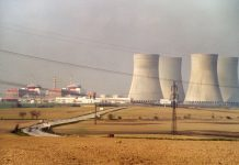 Photo of nuclear power plant next to a city