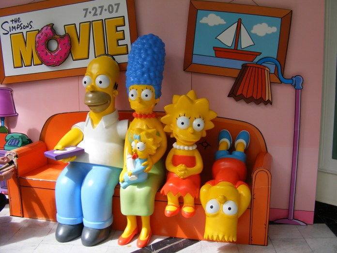 Image of plastic figures of Simpsons characters sitting on a couch