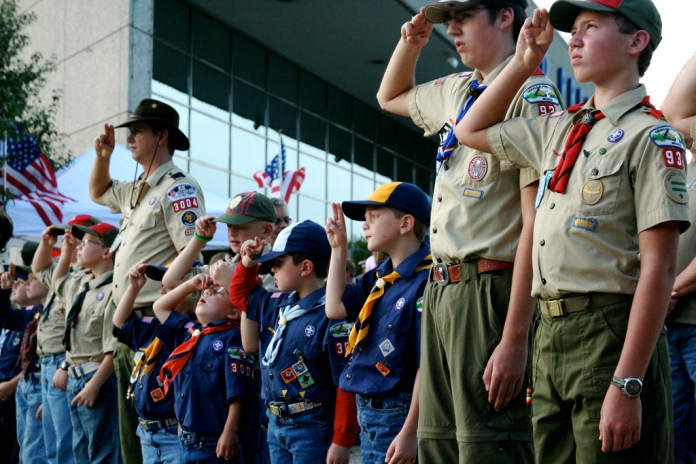 Photo of Boy Scouts saluting.