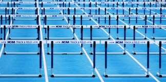 Image of hurdles on a track.