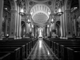 Black and white photograph of the inside of a cathedral