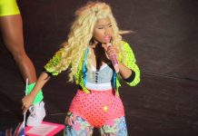 Photograph of Nicki Minaj on stage holding a microphone