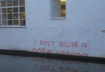 """Banksy is a climate change denier"" by Matt Brown licensed under CC BY 2.0 (via Flickr)."