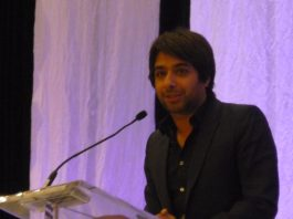 """Jian Ghomeshi"" by Ontario Library Association liscenced under CC BY 2.0 (via Flickr)."