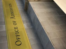 "Photograph of a banner that says ""office of admissions"""