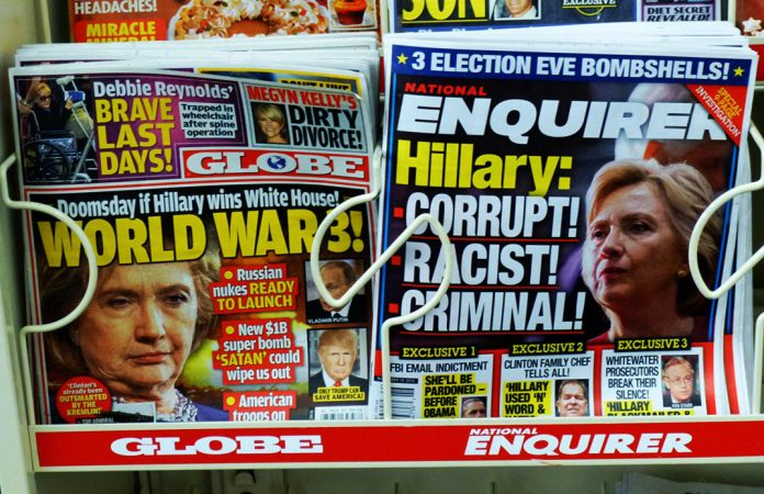 Photograph of two tabloid magazines with headlines about Hilary Clinton, dated