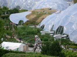 Photograph of people touring glass biospheres