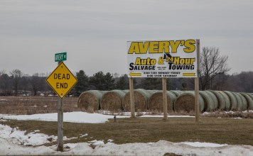 Photograph of a billboard that says Avery's Auto Salvage and 24-Hour Towing