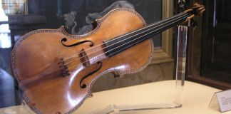 A Stradivarius violin displayed in a museum case