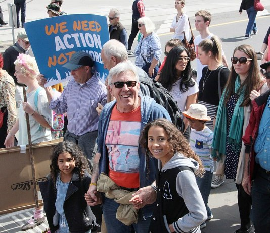 Photo of kids and older adults at a protest