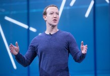 Mark Zuckerberg giving a speech against a blue background