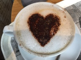 photograph of cappuccino with heart made with foam